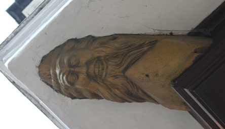 carved-face-on-eave